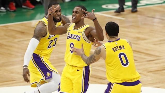 Lakers guard Rajon Rondo (c) celebrates his game-winning basket against the Boston Celtics