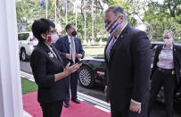 In this photo released by Indonesian Ministry of Foreign Affairs, Indonesian Foreign Minister Retno Marsudi, left, talks to U.S. Secretary of State Mike Pompeo, right, upon his arrival for their meeting in Jakarta, Indonesia, Thursday, Oct. 29, 2020. Pompeo renewed the Trump administration's rhetorical onslaught against China in Indonesia on Thursday as the American presidential election looms. (Indonesian Ministry of Foreign Affairs via AP)
