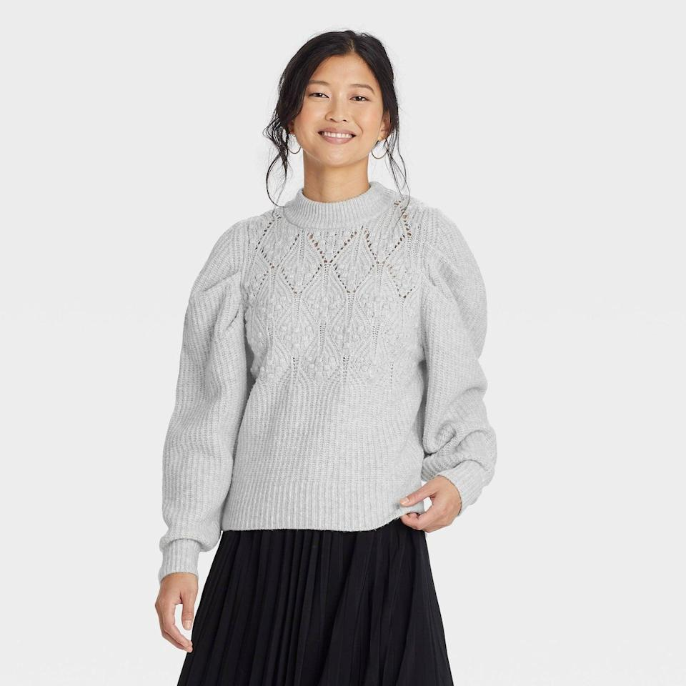 <p>Slip this <span>A New Day Women's Puff Sleeve Crewneck Pullover Sweater</span> ($30) on over a dress for a totally different outfit. The dramatic sleeves make all the difference.</p>
