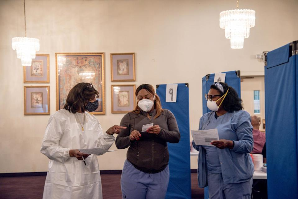 Medical staff at a vaccination site at Greater Emmanuel Institutional church in Detroit, on March 27, 2021. (Cydni Elledge/The New York Times)