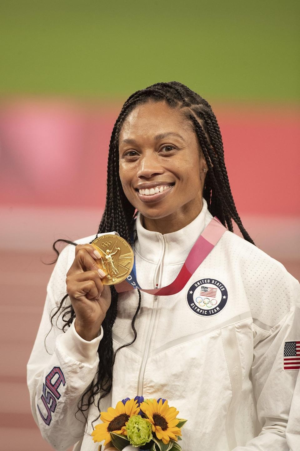 """<p>Five-time Olympian Allyson Felix scored two Olympic medals in Tokyo, becoming <a href=""""http://www.popsugar.com/fitness/how-many-olympic-medals-has-allyson-felix-won-48419847"""" class=""""link rapid-noclick-resp"""" rel=""""nofollow noopener"""" target=""""_blank"""" data-ylk=""""slk:the most decorated Olympian in women's track and field history"""">the most decorated Olympian in women's track and field history</a>. Off the track, she's a true champion, constantly using her platform to bring awareness to the inequities women - and especially mothers - face. If you're feeling inspired (obviously), here's how to re-create her podium look. </p> <ul> <li><span>Athleta Flurry Force Insulated PrimaLoft Jacket II</span> ($139)</li> <li><span>Gold Medal With Ribbon</span> ($1)</li> <li><span>Meiliy 6-Piece Artificial Sunflower Bouquet</span> ($11)</li> </ul>"""