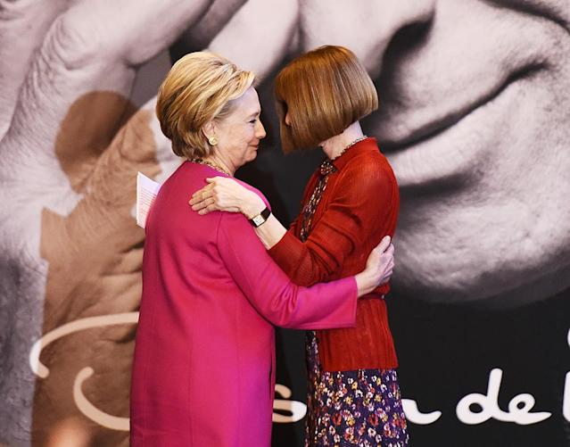 <p><em>Vogue</em> editor in chief Anna Wintour is very particular about what she likes and doesn't like — it's also literally her job to be that way — and she definitely likes Clinton. The two shared a hug in February as they unveiled a collection of U.S. postage stamps designed by Oscar de la Renta. (Photo: Nicholas Hunt/Getty Images) </p>