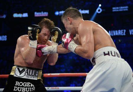 Sep 15, 2018; Las Vegas, NV, USA; Canelo Alvarez (black trunks) and Gennady Golovkin (white trunks) box in the middleweight world championship boxing match at T-Mobile Arena. Alvarez won via majority decision. Mandatory Credit: Joe Camporeale-USA TODAY Sports