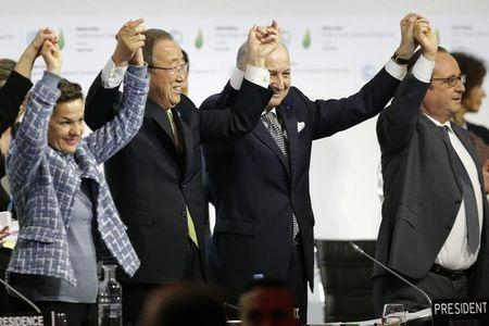 From L-R, Christiana Figueres, Executive Secretary of the UN Framework Convention on Climate Change, United Nations Secretary-General Ban Ki-moon, French Foreign Affairs Minister Laurent Fabius, President-designate of COP21 and French President Francois Hollande react during the final plenary session at the World Climate Change Conference 2015 (COP21) at Le Bourget, near Paris, France, December 12, 2015. REUTERS/Stephane Mahe