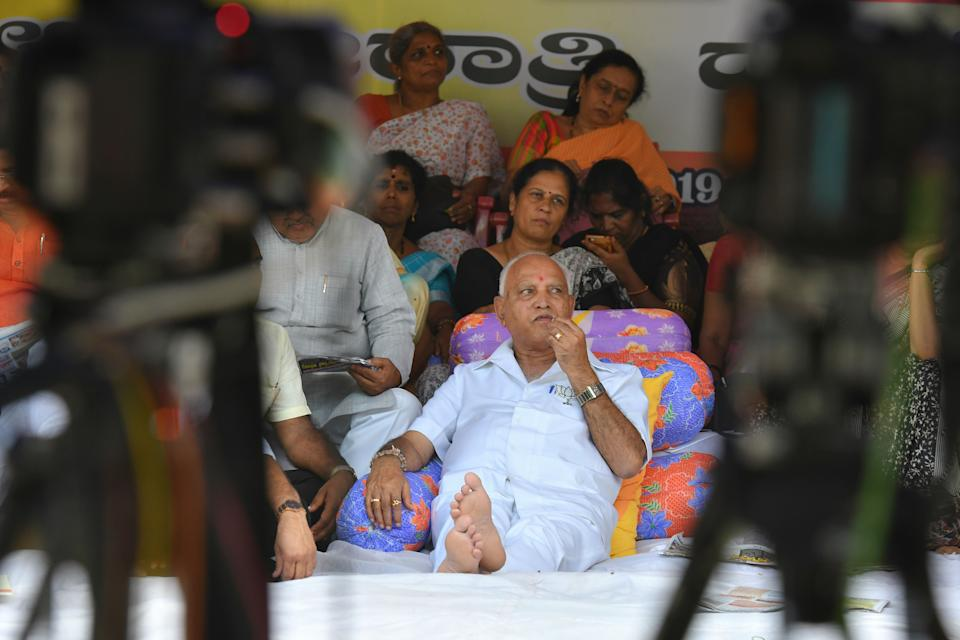 Former chief minister of Karnataka and President of Bharatiya Janatha Party state unit, B.S. Yediyurappa (C) along with party leaders and workers, stages a sit-in protest demonstration in Bangalore on June 14, 2019. - The protest was staged against the decision of the state government to sell government lands to the JSW Steel company at a throwaway price. (Photo by MANJUNATH KIRAN / AFP)        (Photo credit should read MANJUNATH KIRAN/AFP via Getty Images)