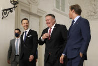 U.S. Secretary of State Mike Pompeo, second right, Austrian Finance Minister Gernot Bluemel, second left, and U.S. ambassador to Austria Trevor Traina, right, arrive for a business roundtable at the Winter Palace in Vienna Austria, Friday Aug. 14, 2020. Pompeo is on a five-day visit to central Europe. (Lisi Niesner/Pool via AP)
