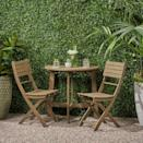 <p>The half table in the <span>Westmount Half-Round Folding Acacia Wood Bistro Set</span> ($210) is perfect for small spaces.</p>