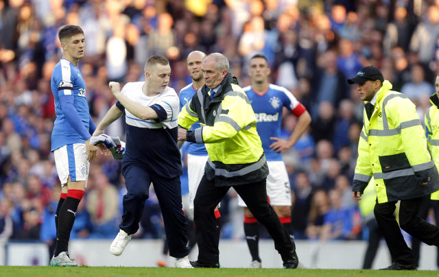 Football - Rangers v St Mirren - Ladbrokes Scottish Championship - Ibrox Stadium - 7/8/15 Match stewards chase after a fan who had invaded the pitch Action Images via Reuters / Graham Stuart Livepic EDITORIAL USE ONLY.