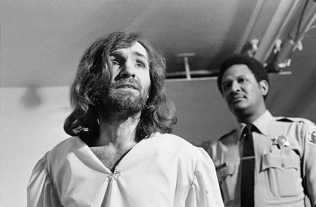 "<p>Charles Manson replies, ""It all depends on your point of view,"" after a newsman asks him, ""Are you insane, Charlie?"" March 19, 1970, in Los Angeles. The exchange came as Manson left court, where he won permission to hire a new attorney, replacing one who had attempted to have Manson examined by psychiatrists. (Photo: George Brich/AP) </p>"