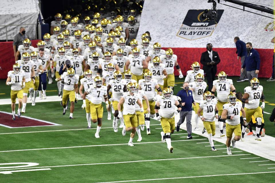 ARLINGTON, TEXAS - JANUARY 01: The Notre Dame Fighting Irish run on the field during player introductions before the College Football Playoff Semifinal at the Rose Bowl football game against the Alabama Crimson Tide at AT&T Stadium on January 01, 2021 in Arlington, Texas. The Alabama Crimson Tide defeated the Notre Dame Fighting Irish 31-14. (Photo by Alika Jenner/Getty Images)