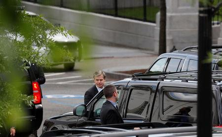 FBI Director Christopher Wray departs after a meeting with U.S. President Donald Trump on FBI investigations into Russia and the 2016 Trump presidential campaign at the White House in Washington U.S