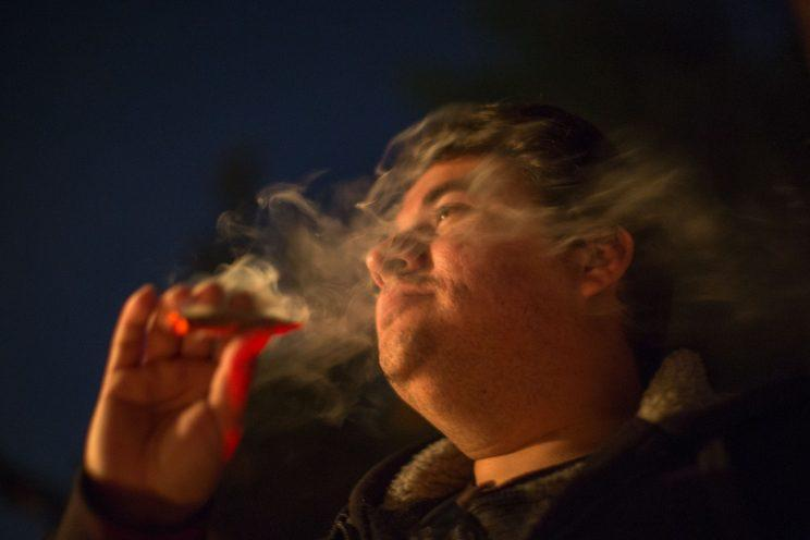 Bert De Loera smokes marijuana at the launch of Privee Social Club, an exclusive cannabis users club, on March 23, 2017 in the Venice section of Los Angeles, Calif. (Photo: David McNews/AFP/Getty Images)