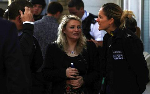 <span>A woman is spoken to by police outside Parsons Green station</span> <span>Credit: KEVIN COOMBS/Reuters </span>