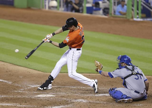 Miami Marlins' Christian Yelich, left, hits a home run during the fifth inning of a baseball game against the Los Angeles Dodgers, Sunday, May 4, 2014, in Miami. (AP Photo/Wilfredo Lee)