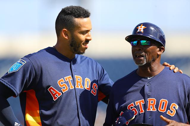 <p>Houston Astro Carlos Correa (1) chats on the field with 3B coach Gary Pettis in the third inning of a baseball game against the Minnesota Twins at the Ballpark of the Palm Beaches in West Palm Beach, Fla., on Feb. 28, 2018. (Photo: Gordon Donovan/Yahoo News) </p>