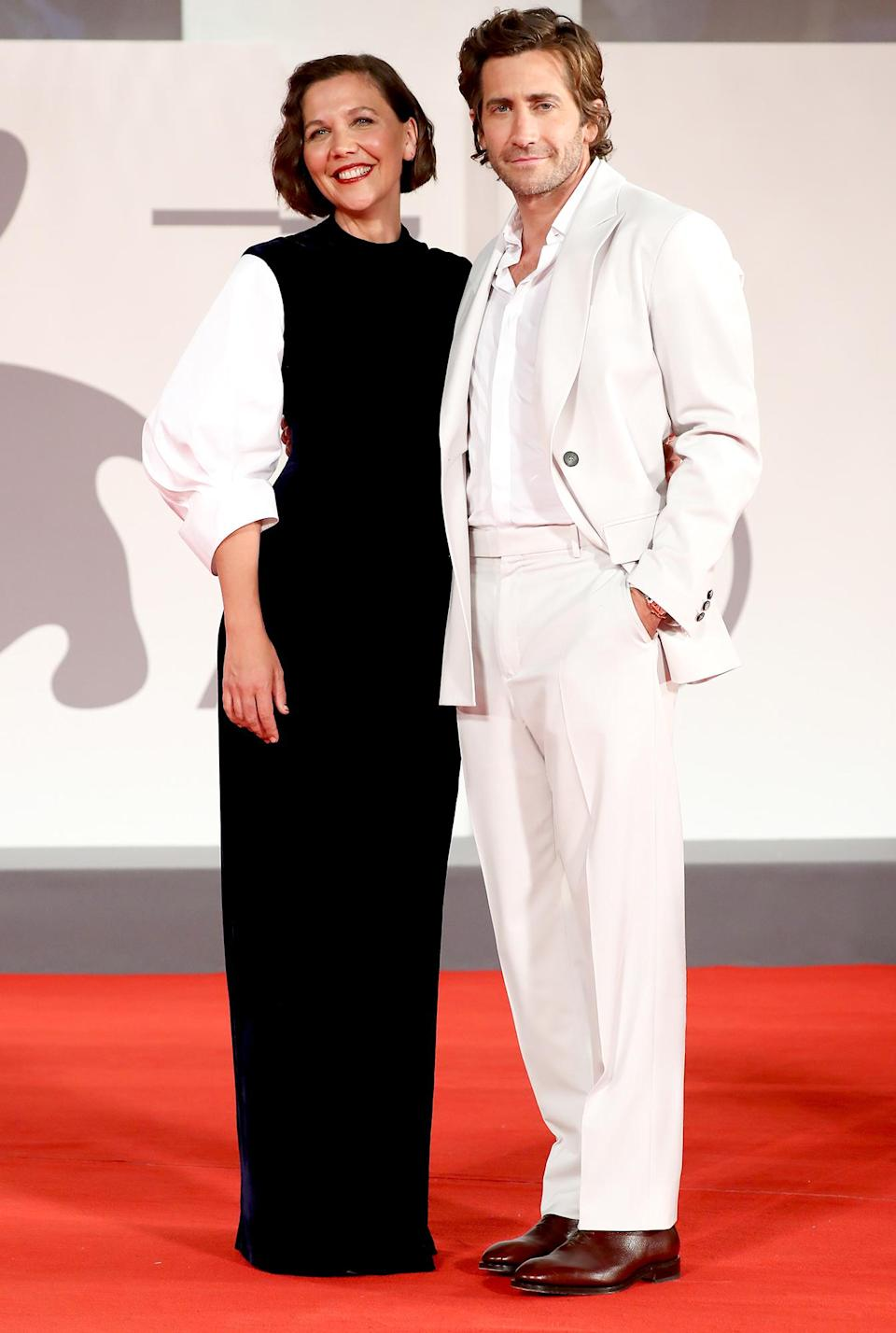 <p>Maggie and Jake Gyllenhaal attend <em>The Lost Daughter</em> red carpet during the 78th Venice International Film Festival on Sept. 3 in Italy.</p>