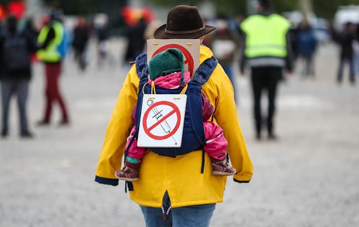 A protester at rally in Stuttgart, Germany, wears a sign signaling opposition to a coronavirus vaccine, May 2, 2020. (Photo: picture alliance via Getty Images)