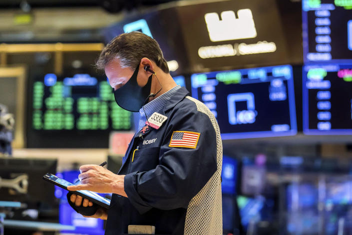 In this photo provided by the New York Stock Exchange, trader Robert Charmak works on the floor, Monday, March 1, 2021. Stocks are rising across the board on Wall Street as traders welcomed a move lower in long-term interest rates in the bond market. Investors were also watching Washington as a big economic stimulus bill moved to the Senate. (Courtney Crow/New York Stock Exchange via AP)
