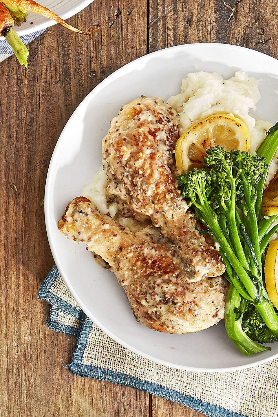 "<p>Dress up drumsticks with a white wine, cream, and Dijon batter.</p><p><strong><a href=""https://www.countryliving.com/food-drinks/recipes/a44268/dijon-smothered-chicken-legs-broccolini-recipe/"" rel=""nofollow noopener"" target=""_blank"" data-ylk=""slk:Get the recipe"" class=""link rapid-noclick-resp"">Get the recipe</a>. </strong></p>"