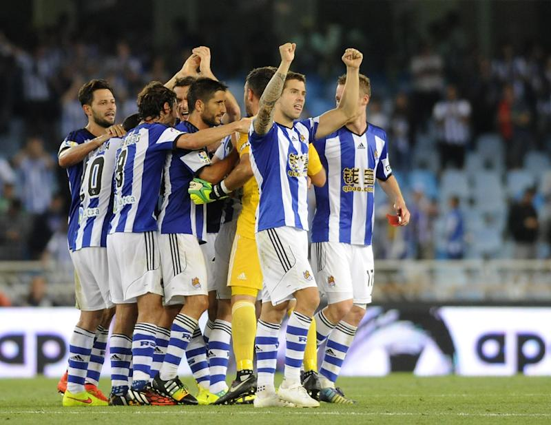 Real Sociedad players celebrate after their La Liga match against Real Madrid in San Sebastian on August 31, 2014
