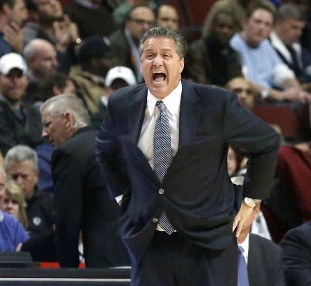 Kentucky coach John Calipari yells to his team during the first half of an NCAA college basketball game against Michigan State on Tuesday, Nov. 12, 2013, in Chicago. (AP Photo/Charles Rex Arbogast)