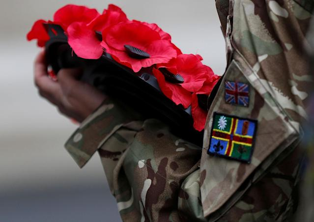 <p>An army cadet holds a poppy wreath during the Western Front Association service at the Cenotaph to remember servicemen and women killed conflict, in London, Britain, Nov. 11, 2017. (Photo: Peter Nicholls/Reuters) </p>