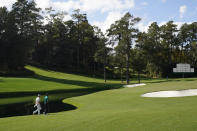 Tiger Woods and Bryson DeChambeau walk up the 15th fairway during a practice round for the Masters golf tournament Monday, Nov. 9, 2020, in Augusta, Ga. (AP Photo/David J. Phillip)