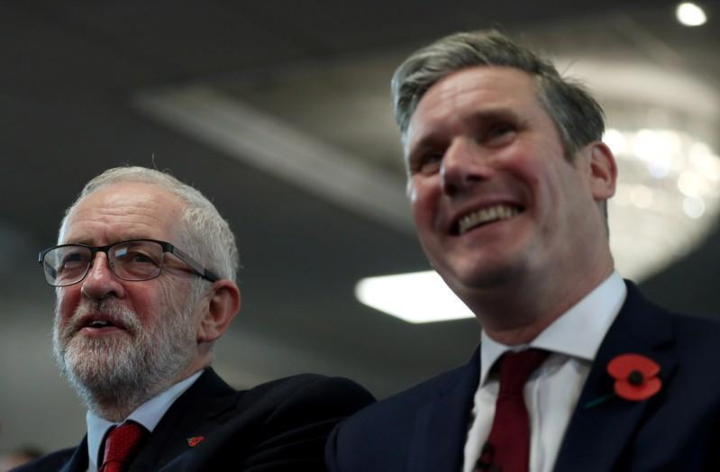 Britain's opposition Labour Party leader Jeremy Corbyn and Shadow Brexit Secretary Keir Starmer attend a general election campaign meeting in Harlow
