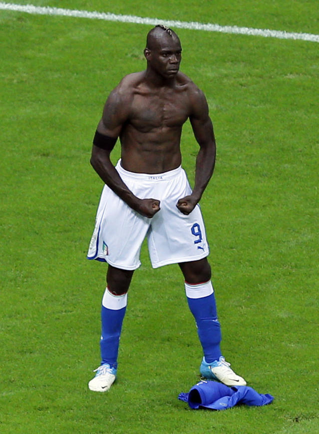 FILE- In this June 28, 2012 file photo, Italy's Mario Balotelli celebrates scoring his side's second goal during the Euro 2012 soccer championship semifinal match between Germany and Italy in Warsaw, Poland. Mario Balotelli could make his first appearance for Italy in nearly four years after being named in a 30-man squad by new coach Roberto Mancini. Balotelli last played for Italy in the 2014 World Cup. He was called up by Antonio Conte in November of that year but was forced to withdraw from the squad with injury. (AP Photo/Vadim Ghirda, File)