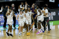 West Virginia players and coaches celebrate after beating Morehead State in a college basketball game during the first round of the NCAA tournament at Lucas Oil Stadium Saturday, March 20, 2021, in Indianapolis. (AP Photo/Mark Humphrey)