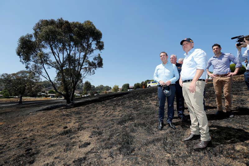 Australian Prime Minister Morrison and SA Premier Marshall stand on the burnt ground of Jacaranda Drive in Woodside following bushfires