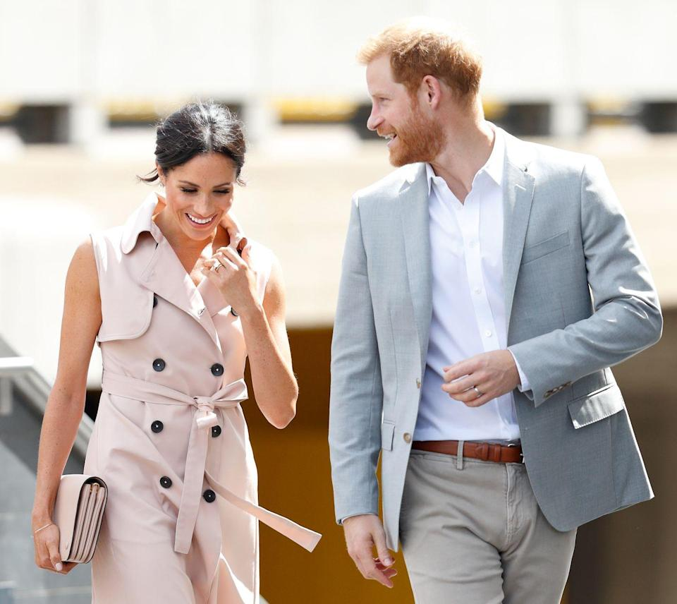 """<p>Meghan and Harry shared a joke together as they attended The Nelson Mandela Centenary Exhibition in London, July 2018. We need that <a href=""""https://www.elle.com/uk/fashion/celebrity-style/a22197589/meghan-markle-pink-sleevless-trench-dress-mandela-centenary-exhibition/"""" rel=""""nofollow noopener"""" target=""""_blank"""" data-ylk=""""slk:House of Nonie dress"""" class=""""link rapid-noclick-resp"""">House of Nonie dress</a> in our lives, ASAP.</p>"""