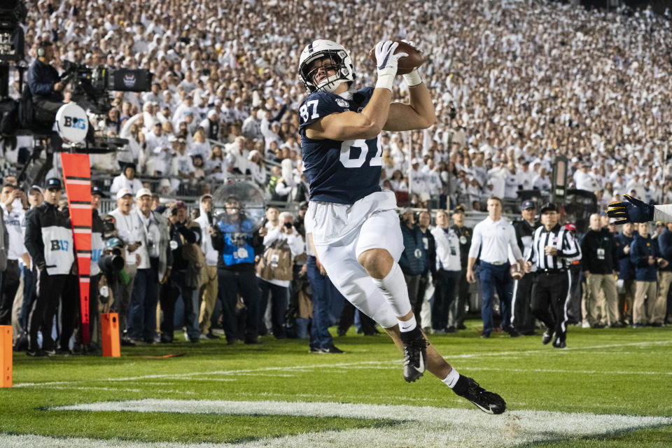UNIVERSITY PARK, PA - OCTOBER 19:  Penn State Nittany Lions Tight End Pat Freiermuth (87) catches a pass for a touchdown during the first half of the game between the Michigan Wolverines and the Penn State Nittany Lions on October 19, 2019, at Beaver Stadium in University Park, PA, (Photo by Gregory Fisher/Icon Sportswire via Getty Images)