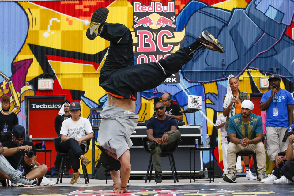 Red Bull BC One judges, from left, B-girl Sunny, All Star Neguin and Kid Gylde, take a look at uncle Will as he battles during Red Bull BC One event on, Saturday, July 24, 2021. in New York. Many in the breaking community are eager for the art form to expand its audience after the International Olympic Committee announced that it would become an official sport at the Paris 2024 games. But that optimism is hardly unanimous. (AP Photo/Eduardo Munoz Alvarez)
