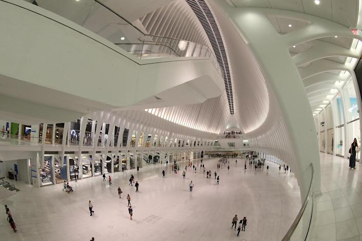 <p>People walk through the Oculus mall at World Trade Center on Wednesday, August 17, 2016. It stretches along a four-block underground network that spans the bases of three office towers. While mostly below street level, light beams in through the windows of the winged Oculus, designed by Santiago Calatrava, that top the transportation hub of 13 subway trains and river ferries. (Gordon Donovan/Yahoo News) </p>