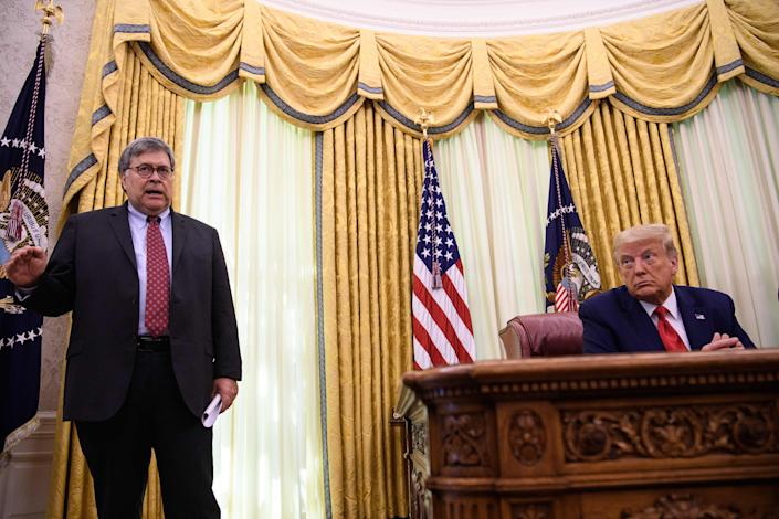 President Trump with Attorney General William Barr in the Oval Office on July 15. (Nicholas Kamm/AFP via Getty Images)