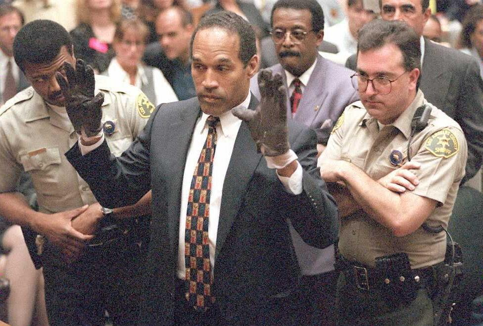 "During his 1995 double murder trial, O.J. Simpson was asked to try on the bloody murder gloves found at the scene, and said they were too small -- his lawyer Johnnie Cochran famously said, ""If it doesn't fit, you must acquit"" (AFP Photo/SAM MIRCOVICH)"