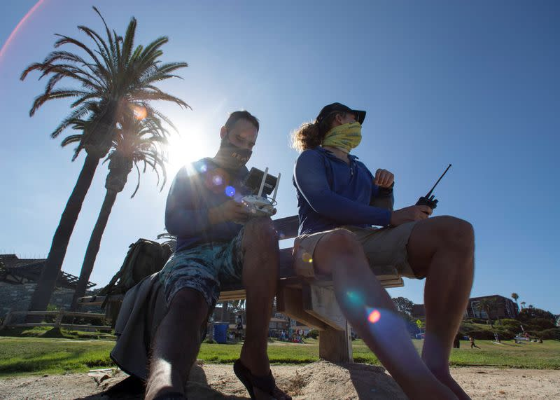 Marine biologists from Cal State Lone Beach Shark Lab study sharks along the California coast