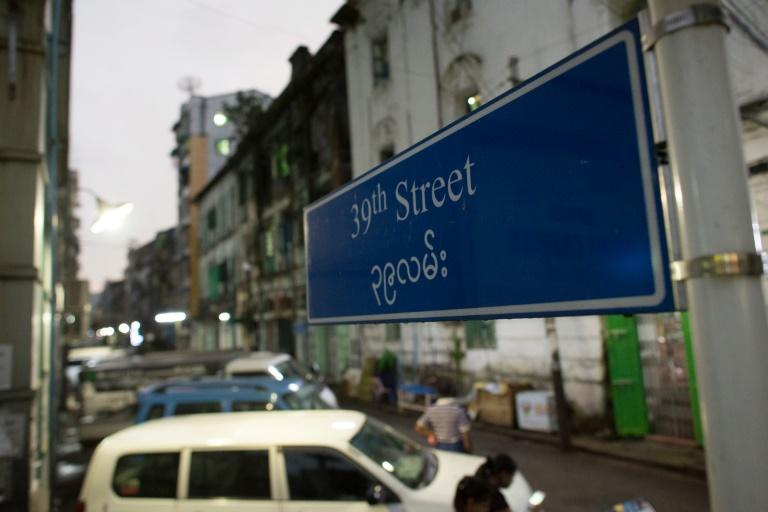 A sign on 39th Street in Yangon where a British man was found dead inside his co-worker's apartment with wounds on his head and chest on November 6, 2016