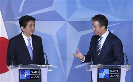 NATO Secretary General Rasmussen and Japanese PM Abe address a news conference at the Alliance headquarters in Brussels