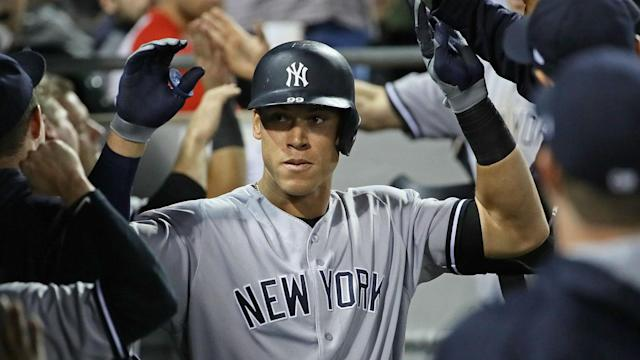 The high-flying New York Yankees hit five home runs to cruise past the Texas Rangers in MLB action.