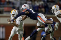 Tennessee quarterback Jarrett Guarantano (2) is tacked by Auburn defensive back Jamien Sherwood (20) as he carries the ball during the first half of an NCAA college football game Saturday, Nov. 21, 2020, in Auburn, Ala. (AP Photo/Butch Dill)