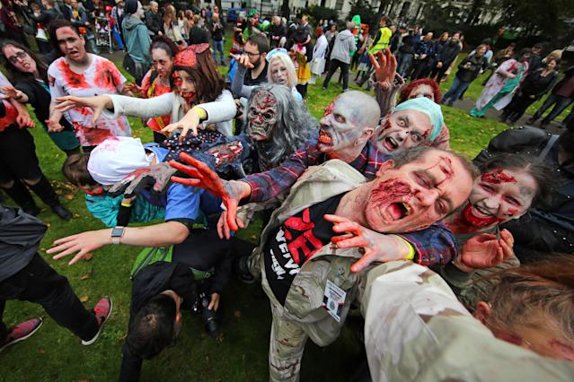 <p>People dressed as zombies wander through London on a pub crawl for World Zombie Day to aid homeless charity in London on Oct. 7, 2017. (Photo: Paul Brown/REX/Shutterstock) </p>
