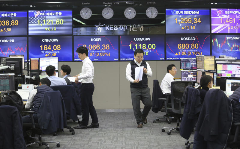 Currency traders work at the foreign exchange dealing room of the KEB Hana Bank headquarters in Seoul, South Korea, Thursday, Jan. 10, 2019. Asian markets were mostly lower Thursday as U.S. and Chinese officials wrapped up three days of talks in Beijing without significant breakthroughs. (AP Photo/Ahn Young-joon)