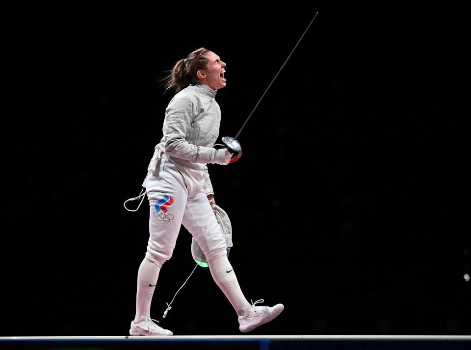 """<p>Russia's Sofia Pozdniakova continues the Pozdniakova family Olympic legacy by winning against Sofya Velikaya in the women's individual sabre at the Makuhari Messe Hall on July 26.</p> <p>Pozdniakova's father is a four-time Olympic champion and the current president of the Russian Olympic committee, according to <a href=""""https://www.nbcolympics.com/news/sofia-pozdniakova-adds-family-legacy-gold-womens-individual-sabre"""" rel=""""nofollow noopener"""" target=""""_blank"""" data-ylk=""""slk:NBC"""" class=""""link rapid-noclick-resp"""">NBC</a>.</p>"""