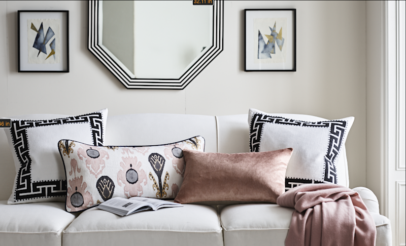 Pillows, including some of the linen Greek key–covered variety favored by Contreras.