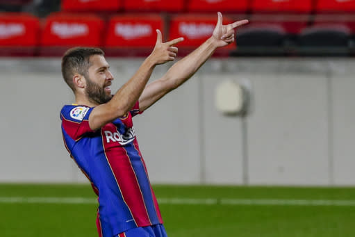 Barcelona's Jordi Alba celebrates after scoring his side's first goal during the Spanish La Liga soccer match between FC Barcelona and Real Sociedad at the Camp Nou stadium in Barcelona, Spain, Wednesday, Dec. 16, 2020. (AP Photo/Joan Monfort)