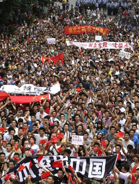 FILE - In this Aug. 19, 2012 file photo, anti-Japan protesters march in Chengdu, in southwestern China's Sichuan province. Chinese government's sensitivity over protests that took place in several Chinese cities on the day over the set of islands, known as Diaoyu in China and Senkaku in Japan, reflects its perpetual fear that allowing its people too much freedom to hold protests, any protests, could snowball into domestic dissidence. (AP Photo/File) CHINA OUT