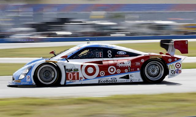 The Ganassi Racing Riley DP goes into a turn during practice for the IMSA Series Rolex 24 hour auto race at Daytona International Speedway in Daytona Beach, Fla., Friday, Jan. 24, 2014.(AP Photo/John Raoux)