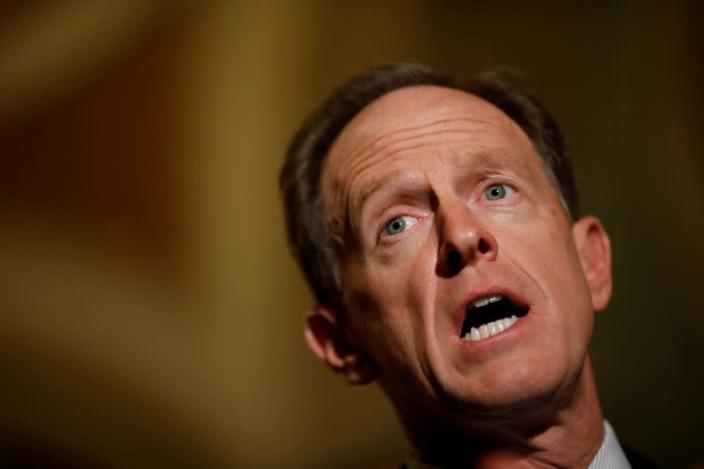 FILE PHOTO: Sen. Pat Toomey (R-PA) speaks with reporters following the party luncheons on Capitol Hill in Washington